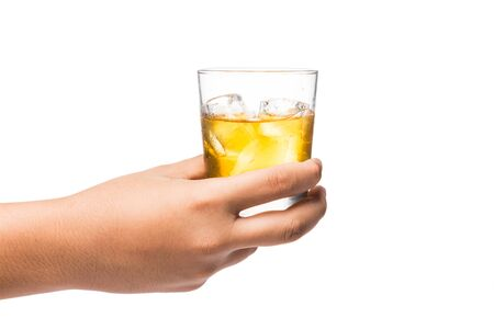 whiskey glass: Hand holding a glass of whiskey on the rocks