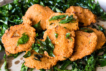 urad dal: Masala Vadai with curry leafs, a popular Southern Indian deep fried snack