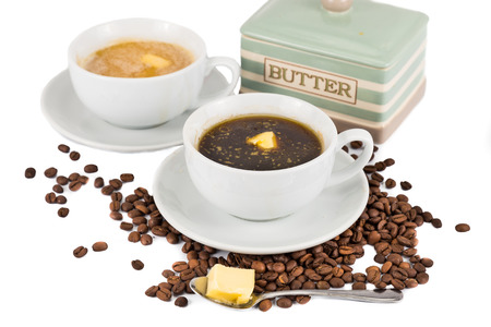 bulletproof: Black coffee with added butter at the foreground and coffee with milk and added butter at the back