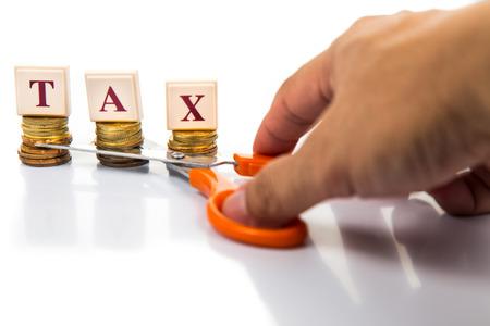 reduce taxes: Cut taxes concept Stock Photo