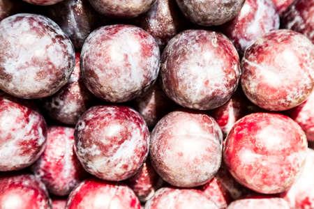 waxy: Pile of fresh plum with waxy white coating
