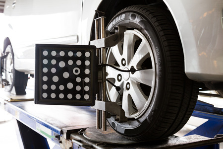 Wheel alignment of a vehicle in progress