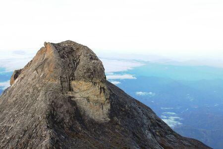 lows: Monkey Face Peak of Mount Kinabalu in Sabah Malaysia
