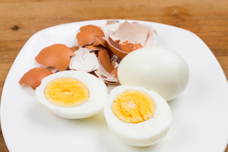 hard boiled: Hard boiled egg with peeled and shattered shells on plate