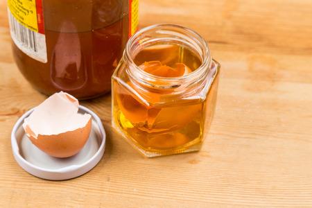 cider: Jar containing soaked egg shell in apple cider vinegar