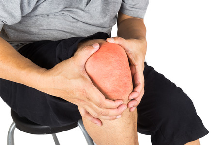 glucosamine: Close up on the painful knee joint of a matured man
