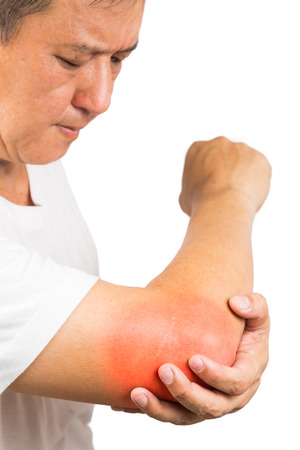glucosamine: Matured man suffering from sore and painful elbow