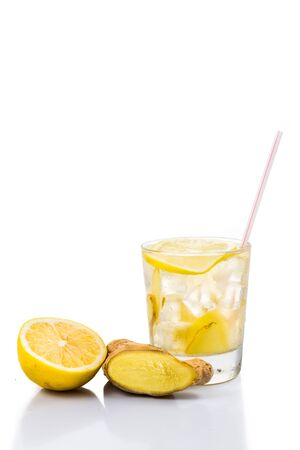 stimulate: Refreshing ice cold ginger lemon tea in transparent glass in portrait orientation Stock Photo