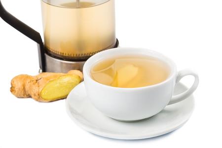tea filter: Hot ginger tea in cup with filter jar