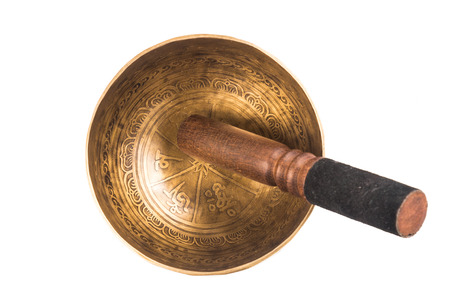 sound healing: Nepali singing bowl isolated in white