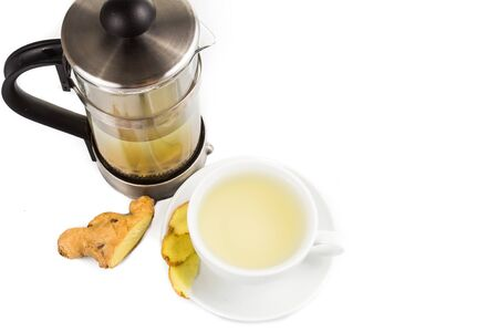 tea filter: Hot ginger tea in cup with filter jar