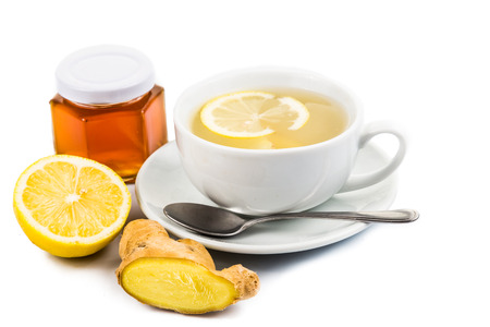 Hot honey lemon and ginger drinks in cup photo