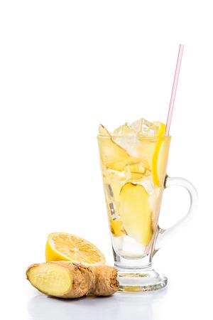 Refreshing ice cold ginger lemon tea in transparent glass photo