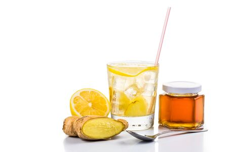 stimulate: Refreshing ice cold honey lemon and ginger tea in transparent glass Stock Photo