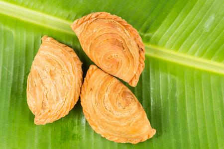 puffs: Curry puffs on banana leafs