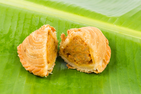 with fillings: Delicious curry puffs with spicy sweet potatoes fillings Stock Photo