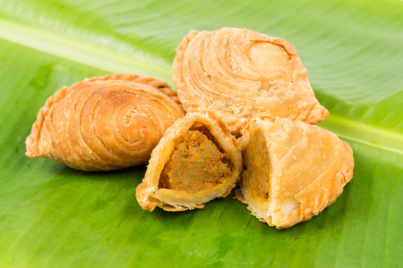puffs: Delicious curry puffs with spicy sweet potatoes fillings Stock Photo