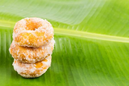 dough nut: Sweet potatoes dough nut ring on banana leaf