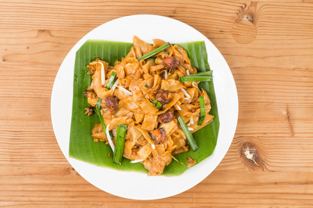 No frills simple Chinese Char Kway Teow or Fried Noodle on banana leaf Stock Photo - 40601411