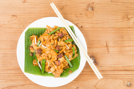 char: No frills simple Chinese Char Kway Teow or Fried Noodle on banana leaf
