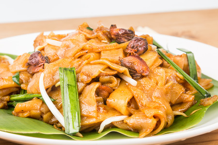 No frills simple Chinese Char Kway Teow or Fried Noodle on banana leaf photo