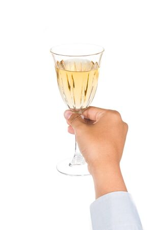 long sleeve shirt: Hands in long sleeve shirt toasting white wine in crystal glasses
