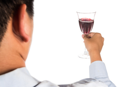 long sleeve shirt: Man in long sleeve shirt toasting red wine in crystal glass