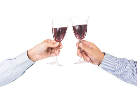 cabernet sauvignon: Hands in long sleeve shirt toasting red wine in crystal glasses