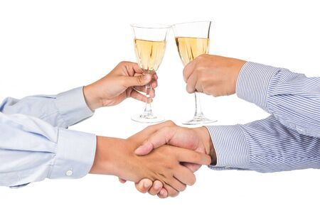 riesling: Men shaking hands and toasting white wine in crystal glass