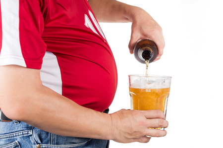 obesity: Obese man with big belly pouring a glass of refreshing beer Stock Photo