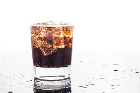 A glass of refreshing cold fizzy cola drinks photo