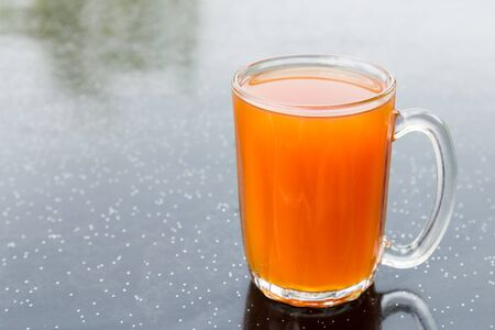 popularly: Freshly brewed black tea in glass mug popularly known as Teh O in Malaysia Stock Photo