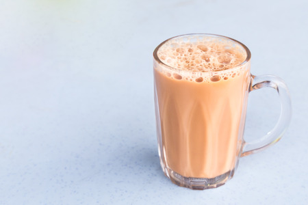 Tea with milk in a mug or popularly known as Teh Tarik in Malaysia
