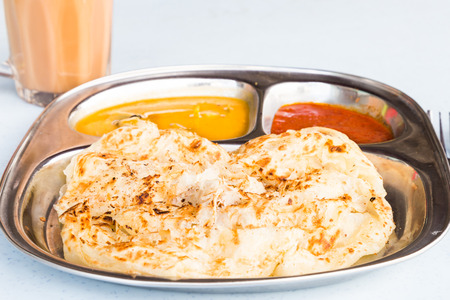 tarik: Roti Prata or Roti Canai a traditional Indian bread served with curry
