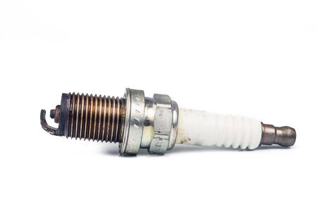 sparking plug: Close up of used spark plugs with focus on the electrode with deposits Stock Photo