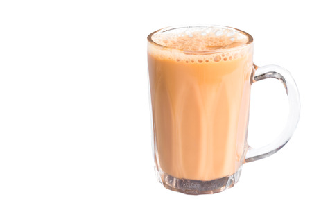 tarik: Mug of milk tea or known as teh tarik isolated in white