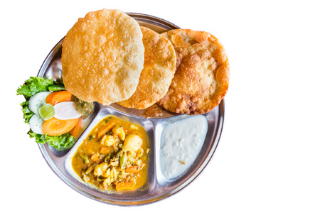 puri: Platter of Nepali puri bread with dhal and yogurt isolated in white