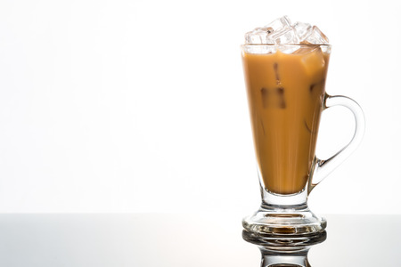 Refreshing iced coffee in tall glass