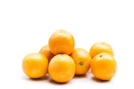 Stack of fresh and juicy naval oranges isolated in white 写真素材