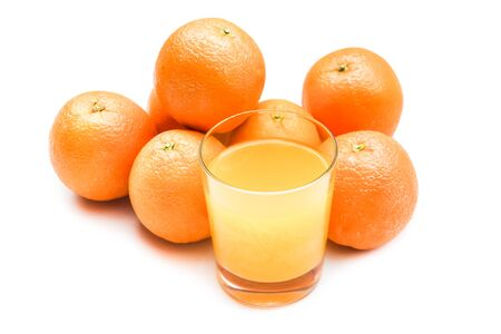 fizzy tablet: Fizzy orange juice from effervescent tablet with oranges at backdrop