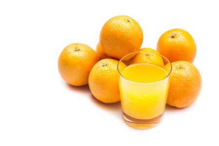 fizzy: Fizzy orange juice from effervescent tablet with oranges at backdrop