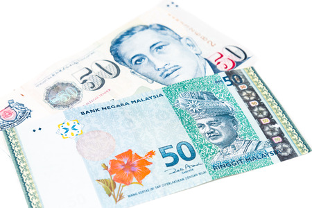 Close up of Singapore Dollar currency note against Malaysia Ringgit.