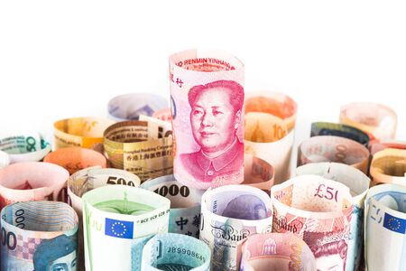 us paper currency: Pile of rolled-up currency notes with China Yuan Renminbi on top. Stock Photo