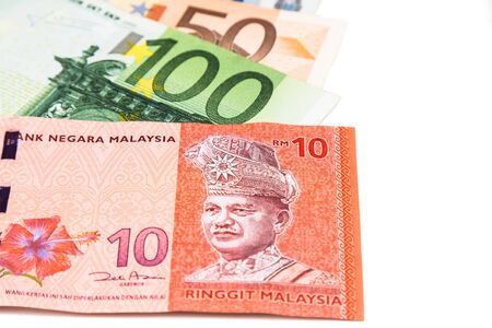 Close up of Malaysia Ringgit currency note against EURO.