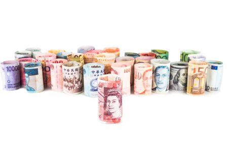 sterlina: Pile di moneta arrotolato note con Sterling Pound nel carattere.