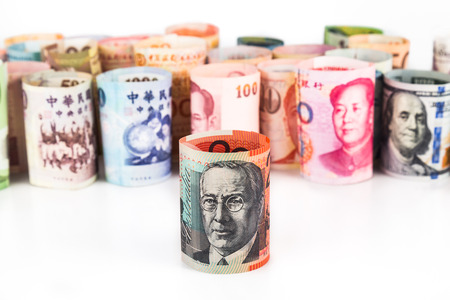 australian dollar notes: Pile of rolled-up currency notes with Australian Dollar in font.