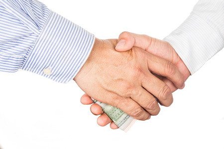 corrupt: Hand shake deal with corrupt cash exchange Stock Photo