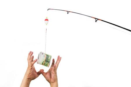 釣り糸に餌としてキャストのお金に手を伸ばす手の概念。