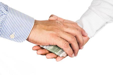 corrupcion: mucho temblor de la mano con el intercambio de dinero corrupto. Foto de archivo