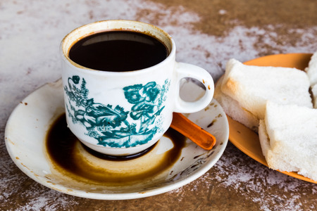 kopitiam: Traditional oriental Chinese coffee in vintage mug and hot buns served in coffee shop